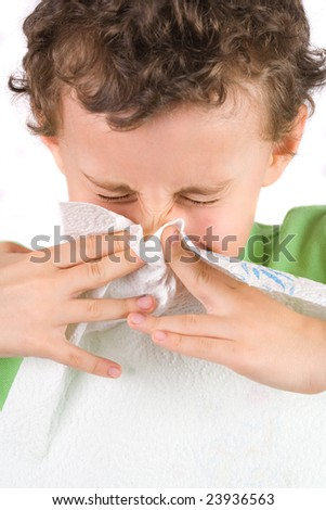 Close-up portrait of a child wiping his nose - stock photo
