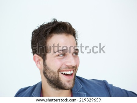 Close up portrait of a cool guy with beard laughing on white background - stock photo
