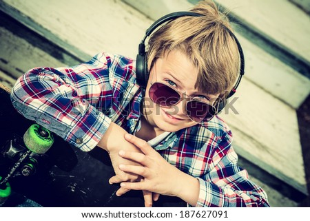 close up portrait of a cool skater boy, vintage effect added - stock photo
