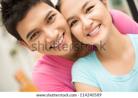 Close up portrait of a couple having good time together - stock photo
