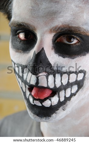 close-up portrait of a creepy skeleton guy perfect for Carnival (brick wall background)