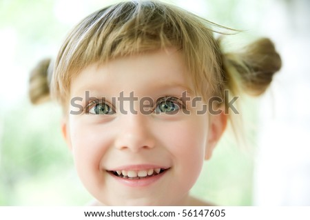 Close-up portrait of a cute liitle girl - stock photo