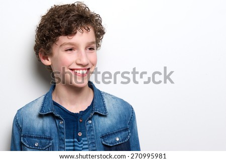 Close up portrait of a cute little boy with curly hair smiling on white background - stock photo