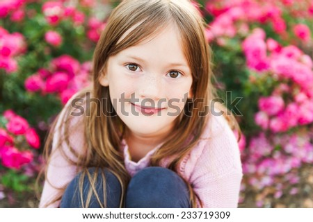 Close up portrait of a cute little girl resting outdoors on a nice sunny evening - stock photo