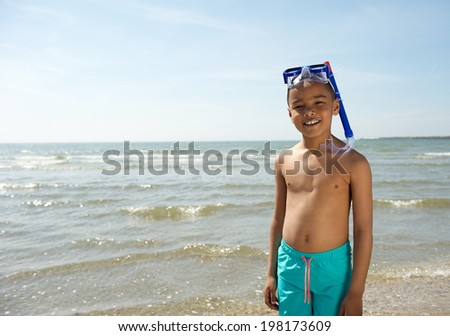 Close up portrait of a cute little kid smiling with snorkel  - stock photo