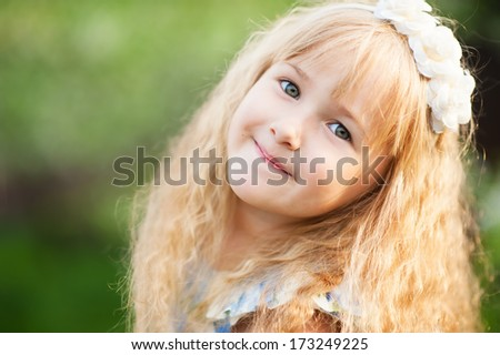 close up portrait of a cute smiling girl in summer day  - stock photo