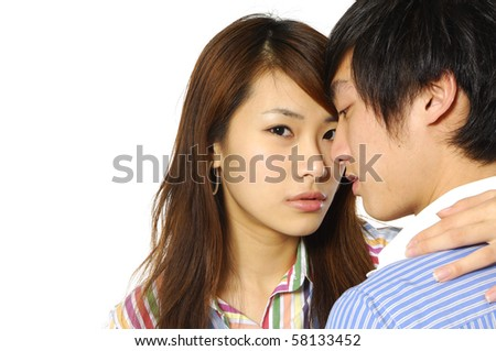 Close up portrait of a cute young woman with her boyfriend - stock photo