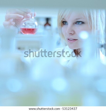 Close-up portrait of a female researcher working in a lab - stock photo