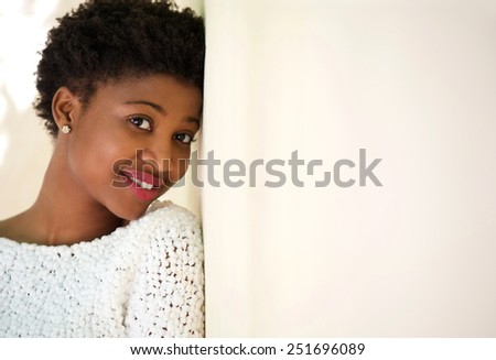Close up portrait of a friendly young african american girl - stock photo