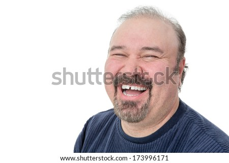 Close-up portrait of a funny mature man laughing hard on a white background - stock photo