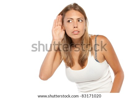 Close-up portrait of a girl listening gossip over white background - stock photo