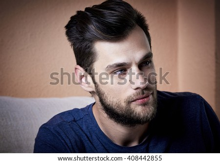 Close-up portrait of a good looking beautiful young man with beard. Black & white picture. - stock photo