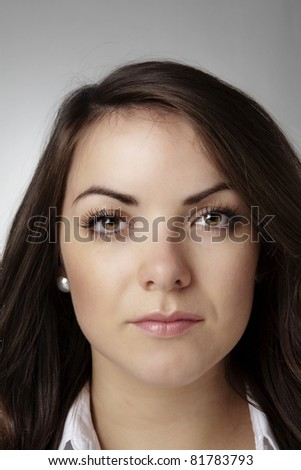 close up portrait of a good looking woman shot in the studio - stock photo
