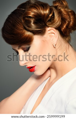 Close-up portrait of a gorgeous young woman. Beauty, fashion. Make-up.   - stock photo