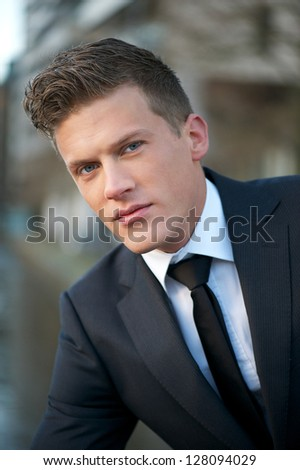 Close up portrait of a handsome business man - stock photo