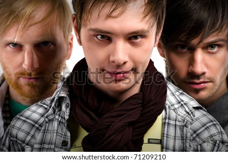 Close-up portrait of a handsome guys - stock photo