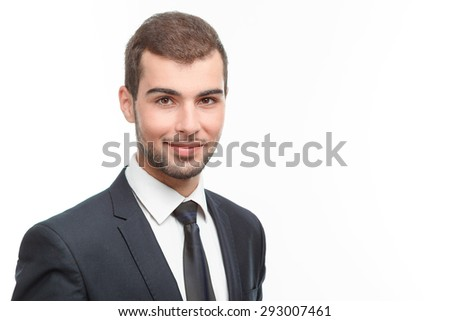 Close up portrait of a handsome young bearded man wearing a formal black suit standing smiling, isolated on white background - stock photo