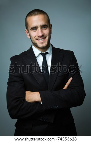 Close-up portrait of a handsome young business man - stock photo