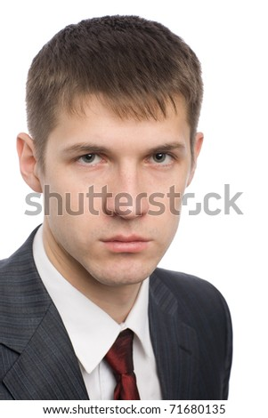 Close-up portrait of a handsome young businessman. - stock photo