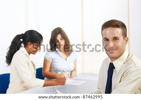 Close up portrait of a handsome young Caucasian businessman with a Tablet PC. - stock photo