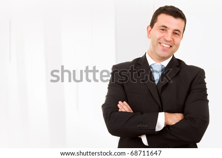 Close-up portrait of a handsome young man in a business suit - stock photo