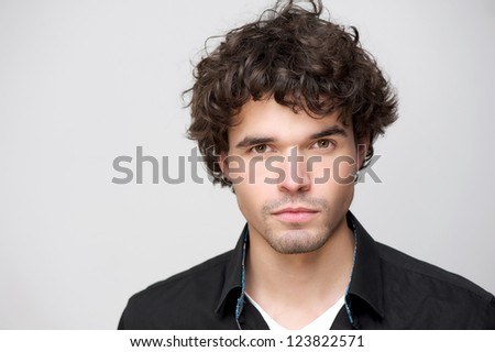 Close up portrait of a handsome young man looking at camera. - stock photo