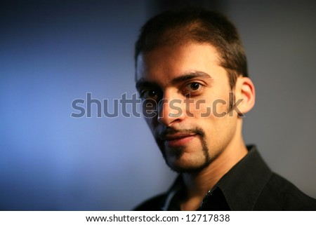 Close-up portrait of a handsome young man. Shallow DOF. - stock photo