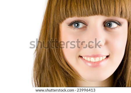 Close-up portrait of a happy blonde girl isolated on white