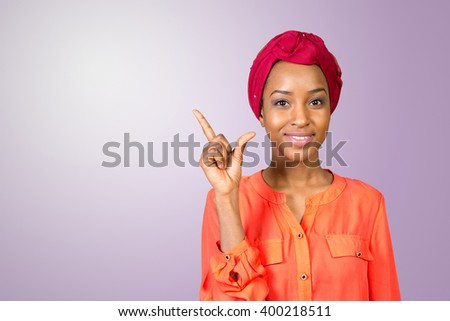 Close up portrait of a happy business woman pointing finger - stock photo