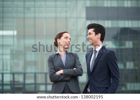 Close up portrait of a happy businessman and business woman smiling - stock photo