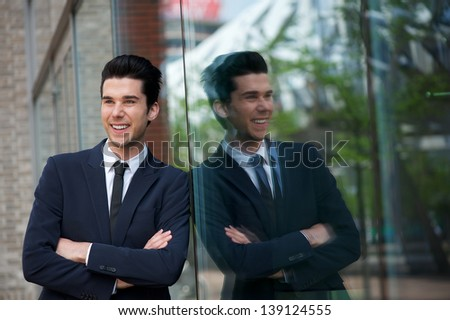 Close up portrait of a happy businessman smiling outdoors - stock photo