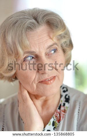 close-up portrait of a happy elderly woman in studio