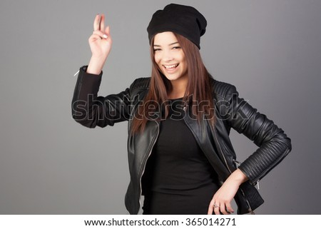 Close-up portrait of a happy girl excited. Young woman smiling very happy surprised holding head being amazed. Funky smile. Female model joyful and playful. - stock photo
