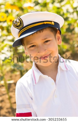 Close-up portrait of a happy kid who dreams of becoming a pilot - stock photo