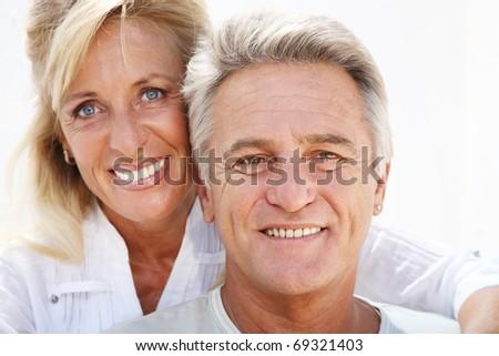 Close-up portrait of a happy mature couple smiling. - stock photo
