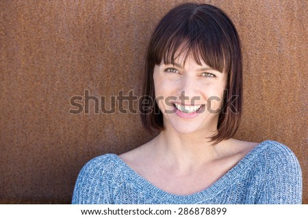 Close up portrait of a happy middle aged woman - stock photo