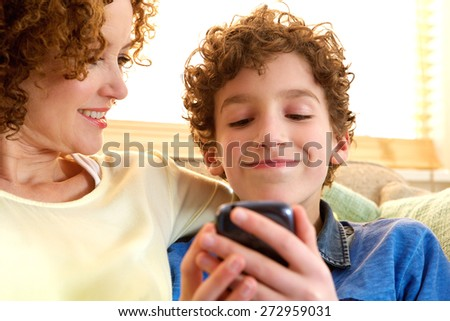 Close up portrait of a happy mother and son together at home - stock photo