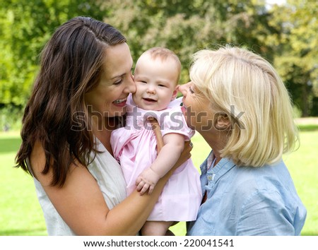 Close up portrait of a happy mother with child and grandmother outdoors