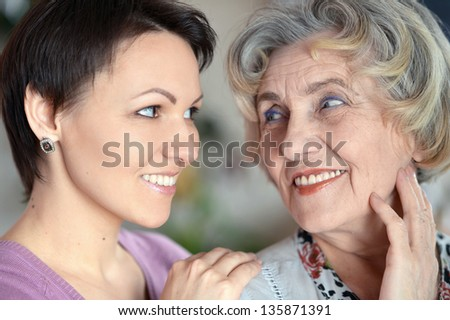 close-up portrait of a happy older woman and a young woman - stock photo