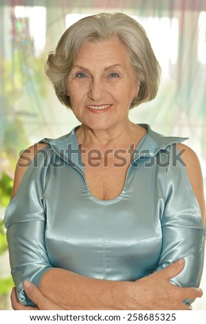 Close-up portrait of a happy older woman at home - stock photo