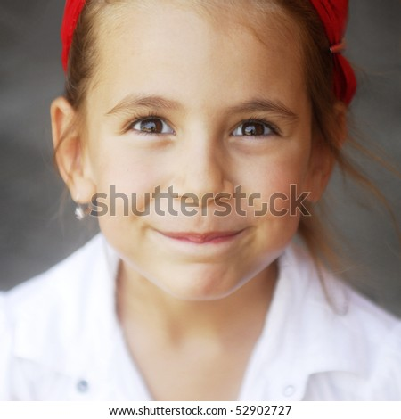 close-up portrait of a happy smiling little girl - stock photo