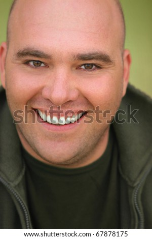 Close up portrait of a happy smiling middle aged man with bald head - stock photo