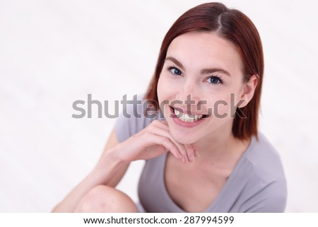 Close up portrait of a Happy young beautiful woman relax sitting and smile to you, caucasian beauty - stock photo