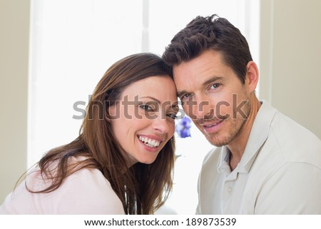 Close-up portrait of a happy young couple at home - stock photo