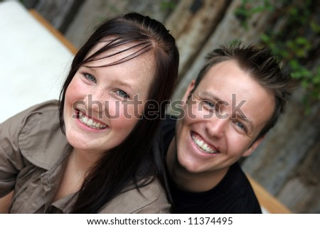 Close-up portrait of a happy young couple (focus on the woman).