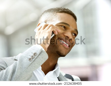 Close up portrait of a happy young man calling by mobile phone - stock photo