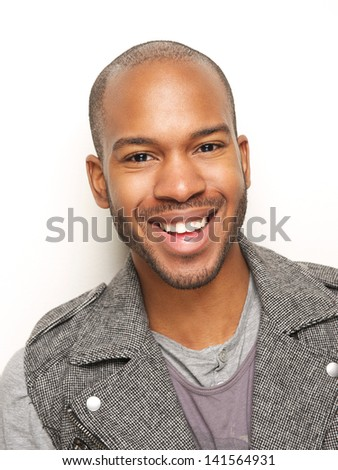Close up portrait of a happy young man smiling - stock photo