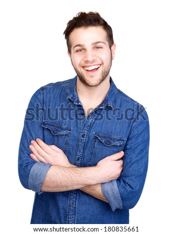 Close up portrait of a happy young man smiling with arms crossed on isolated white background - stock photo