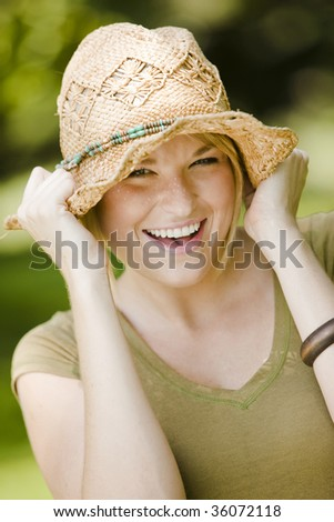 Close-up portrait of a happy young pretty woman smiling - stock photo