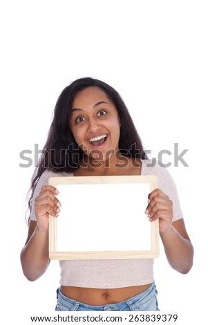 Close up Portrait of a Happy Young Woman Holding Empty Small White Board with Text Space While Looking at the Camera with Wide Open Eyes and Open Mouth. Isolated on White Background.